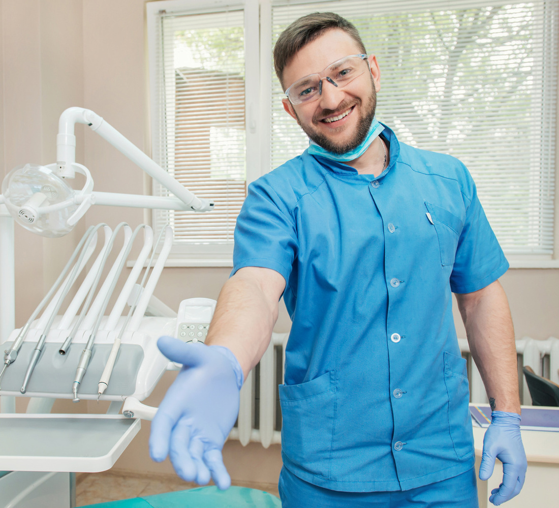 Smiling dentist giving his hand for a handshake
